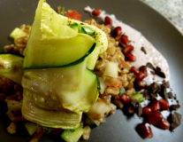 Dancing Lion - zucchini & fennel rotini on very dark chocolate infused farro with garlic scapes and fig cream.