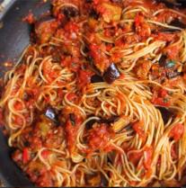Piccola - Pasta alla Siciliano house-made spaghetti, pomodoro sauce, eggplant, oregano, and thyme, topped with garlic and parmesan