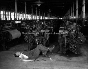 Man lying on the floor after stepping on several bobbin