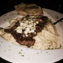 N'awlins | Cream Fettuccine Alfredo topped with an 8 oz Ribeye steak.
