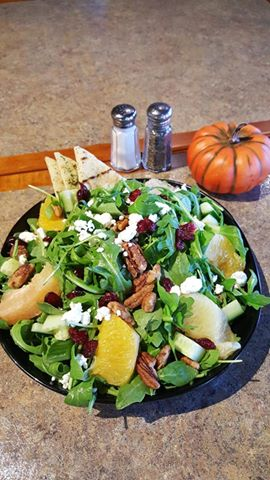 Waterworks Cafe | Citrus Salad- Baby Arugula tossed with White Balsamic Vin topped with Oranges, Grapefruit, cucumbers, goat cheese and crumbled pecans